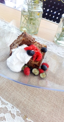 Never mind about healthy! Here comes the choc chip banana bread, coconut cream and berries.