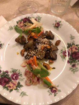 A guest's picture of the second course of sesame aubergine served with lightly pickled veg, pea shoots, and turmeric roasted cashews