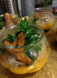 The main course featured a spiced butternut soup, rice noodles, peanut tofu and flash-fried kale